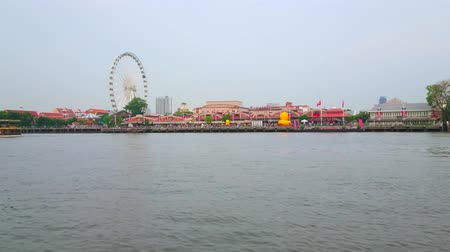 phraya : BANGKOK, THAILAND - MAY 15, 2019: The view from Chao Phraya river on Asiatique The Riverfront shopping mall with its colorful pavilions and ferris wheel, on May 15 in Bangkok