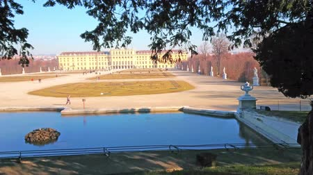 barroque : VIENNA, AUSTRIA - FEBRUARY 19, 2019: Watch the Schonbrunn Palace, garden (Shlosspark, Bundesgarten) and a pond of Neptune fountain, on February 19 in Vienna