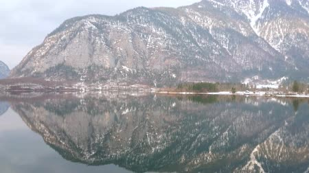 hallstatter see : Panorama of iconic Alpine Hallstattersee lake and snowy Dachstein mountains, reflecting on its mirror surface, Hallstatt, Salzkammergut, Austria.