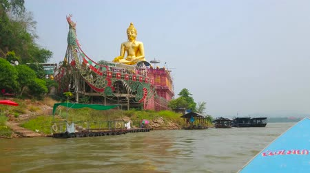 falu : SOP RUAK, THAILAND - MAY 10, 2019: Boat trip through Mekong and Ruak rivers in Golden Triangle area between Thailand, Laos and Myanmar with a view on Buddhist shrine, on May 10 in Sop Ruak
