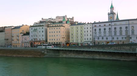 zegar : Historical edifices of Altstadt district located on the Rudolfskai embankment of Salzach river, Salzburg, Austria Wideo