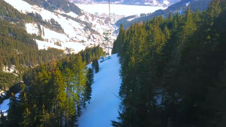 リフト : Explore Zell Am See and visit Schmittenhohe mountain, popular as a ski zone with perfect network of chairlifts and cable cars, Austria 動画素材