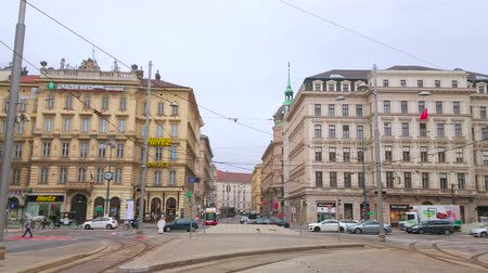historical : VIENNA, AUSTRIA - MARCH 3, 2019: The busy crossroad at the Schwarzenberg Square with beautiful edifices, driving cars and tourist horse-drawn carriages, on March 3 in Vienna.