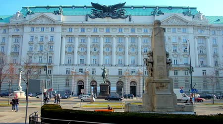 historical : VIENNA, AUSTRIA - FEBRUARY 18, 2019: The facade of historical Government building (former War Ministry) with Radetzky statue and monument of Georg Coch on the foreground, on February 18 in Vienna.
