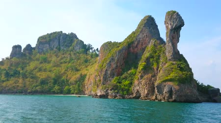 aonang : The picturesque rocky landscape of Koh Kai (Chicken Island), coated with lush tropical greenery and surrounded by emerald waters of Andaman sea, Ao Nang, Krabi, Thailand Stock Footage