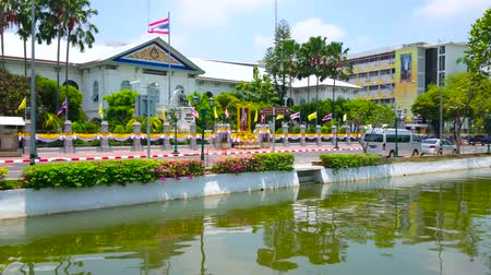 states : BANGKOK, THAILAND - APRIL 23, 2019: Rop Krung canal in front of the edifice of Ministry of Internal Affairs, decorated with flags and garlands due to coronation of King Rama X, on April 23 in Bangkok