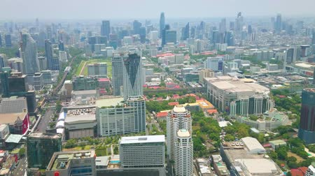 semt : BANGKOK, THAILAND - APRIL 24, 2019; The birds-eye view on new districts of Bangkok with outstanding modern architecture and maze of busy roads from the top of Baiyoke Tower II, on April 24 in Bangkok