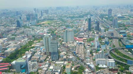 torre : BANGKOK, THAILAND - APRIL 24, 2019: The modern districts with futuristic architecture, metal and glass high rises, curved highways stretching to the city horizon, on April in Bangkok