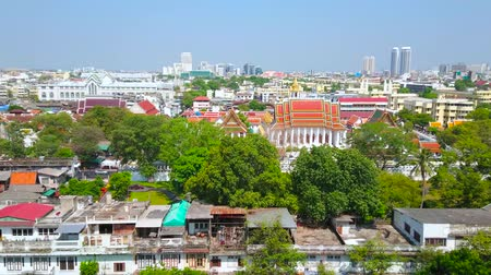 pom : BANGKOK, THAILAND - APRIL 24, 2019: Panoramic view of the central district with magnificent Loha Prasat temple amid the greenery, on april 24 in Bangkok Stock Footage