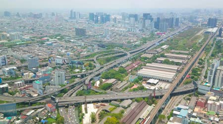 semt : BANGKOK, THAILAND - APRIL 24, 2019:  Watch the fast city traffic through the curved Expressway, Tollway and highway from the top of Baiyoke Tower II, on April 24 in Bangkok Stok Video