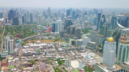 torre : BANGKOK, THAILAND - APRIL 24, 2019: Panorama of business district, that boasts numerous skyscrapers with futuristic design, creating unique face of modern city, on April 24 in Bangkok
