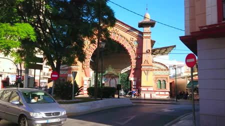 torre : MALAGA, SPAIN - SEPTEMBER 26, 2019: The traffic in front of Neo-Mudejar style Salamanca Market with arabesques, carvings, horse-shoe portal and small towers on the sides, on September 26 in Malaga