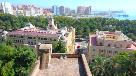 torre : MALAGA, SPAIN - SEPTEMBER 26, 2019: Panorama from the top of Alcazaba Malaga Fortress with a view on University building, Town Hall, city park, marina and port, on September 26 in Malaga