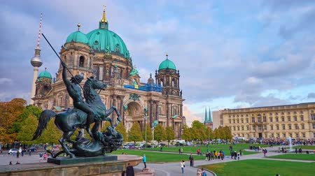 bell tower : BERLIN, GERMANY - OCTOBER 3, 2019: The view from the balustrade of Old Museum on bronze sculpture of the Lion Fighter, people in Lustgarten Park and huge Cathedral, on October 3 in Berlin