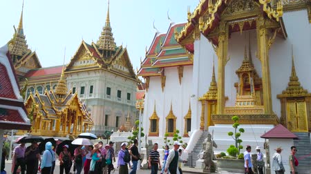BANGKOK, THAILAND - MAY 12, 2019: The view on Phra Thinang Dusit Maha Prasat Hall and Chakri Maha Prasat Throne Hall with crowd of Grand Palace visitors on the foreground, on May 12 in Bangkok