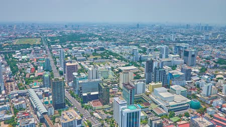 semt : BANGKOK, THAILAND - APRIL 24, 2019: Full circle timelapse from Baiyoke Tower II observation platform with a view on modern skyscrapers, Expressway, Tollway and highway roads, on April 24 in Bangkok Stok Video