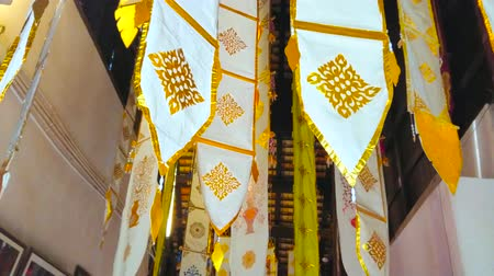 kolumna : CHIANG MAI, THAILAND - MAY 2, 2019: Traditional Lanna ritual banners, decorated with gilt patterns, hang from the ceiling of Wat Phan Tao viharn, on May 2 in Chiang Mai