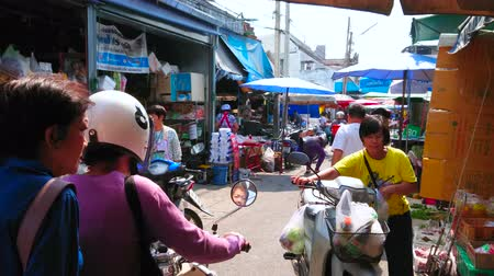CHIANG MAI, THAILAND - MAY 4, 2019: The crowded alley of Gate Market, occupying Pra Pok Clao Road with household, souvenir and food stalls, on May 4 in Chiang Mai