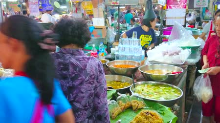 CHIANG MAI, THAILAND - MAY 4, 2019: The Gate Market stalls offer wide range of local foods - stewed vegetables, soups and noodles to takeaway, on May 4 in Chiang Mai