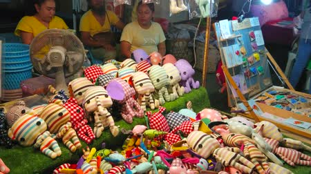 noc : CHIANG MAI, THAILAND - MAY 4, 2019: The stall of handmade textile toys and magnets in Saturday Night Market, Wualai walking street, on May 4 in Chiang Mai