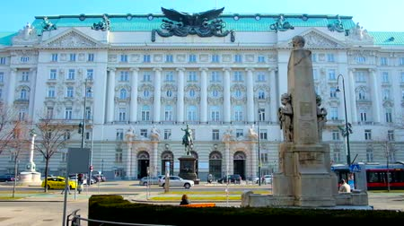 semt : VIENNA, AUSTRIA - FEBRUARY 18, 2019: Historical Government building (former War Ministry) with Radetzky statue, busy traffic and monument of Georg Coch on the foreground, on February 18 in Vienna