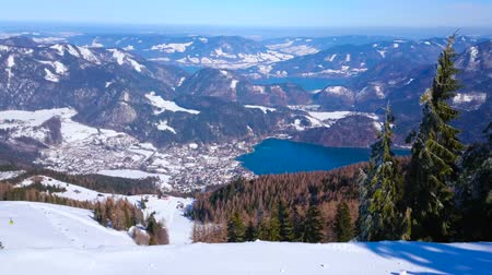sníh : Zwolferhorn mount ski resort is perfect place for winter sport activity and sightseeing, it boasts spectacular views and idyllic Alpine nature, St Gilgen, Salzkammergut, Austria