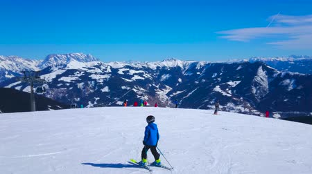 ZELL AM SEE, AUSTRIA - FEBRUARY 28, 2019: Fine weather on Schmitten mount is nice chance to observe winter panorama and enjoy the snowy slopes and sharp Alpine peaks, on February 28 in Zell Am See