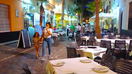 kúszónövény : CADIZ, SPAIN - SEPTEMBER 19, 2019: Calle Virgen de la Palma is the famous seafood street with popular fish restaurants that is always busy in the evening, on September 19 in Cadiz