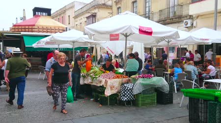 bakkaliye : JEREZ, SPAIN - SEPTEMBER 20, 2019: Busy Dona Blanca street at Mercado Central de Abastos (Abastos Market) with small fruit-vegetable stores and churros snack pavilions, on September 20 in Jerez