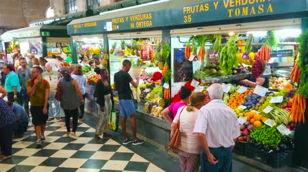 bakkaliye : JEREZ, SPAIN - SEPTEMBER 20, 2019: Mercado Central de Abastos (Sentral Abastos Market) grocery division with large variety of fresh fruits and vegetables in small stalls, on September 20 in Jerez