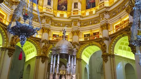 incarnation : GRANADA, SPAIN - SEPTEMBER 25, 2019: The vertical panorama of Capilla Mayor (Main Chapel) of Incarnation Cathedral with rich decors and massive arcade on background, on September 25 in Granada Stock Footage