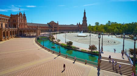 mudejar : SEVILLE, SPAIN - OCTOBER 2, 2019: The architectural ensemble of Plaza de Espana (Spain Square) with spectacular edifice, narrow half-round canal with boats and fountain, on October 2 in Seville