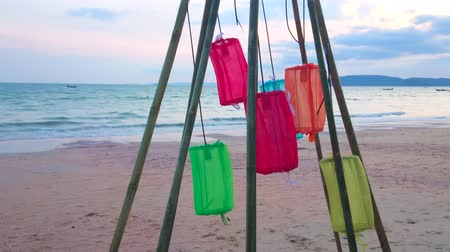 The beachline of Ao Nang with colorful lanterns on the foreground, Krabi, Thailand