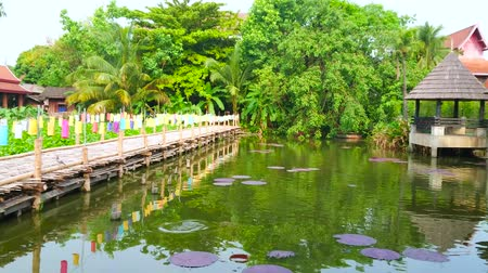 pantanal : CHIANG MAI, THAILAND - MAY 4, 2019: Panorama of the garden of Wat Chetlin temple with a pond, shady pavilions, bamboo bridges, monastic building and lush greenery, on May 4 in Chiang Mai