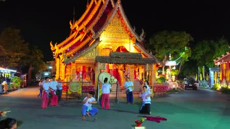 luta : CHIANG MAI, THAILAND - MAY 4, 2019: The group of young men performs street warrior dance with swords and drums in front of Wat Sri Suphan, on May 4 in Chiang Mai