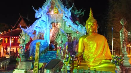 gravure : CHIANG MAI, THAILAND - MAY 4, 2019: The frontage of the stunning Silver Temple (Wat Sri Suphan) in evening lights with ornate statues, patterns, reliefs and gilt Buddha Image, on May 4 in Chiang Mai
