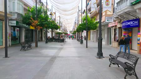 markiza : SANLUCAR, SPAIN - SEPTEMBER 22, 2019: Calle Ancha is main shopping promenade, lined with bars, restaurants, fashion boutiques and souvenir shops, located in old edifices, on September 22 in Sanlucar