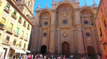 incarnation : GRANADA, SPAIN - SEPTEMBER 25, 2019: Panorama of medieval Pasiegas square with historical edifices and monumental stone facade of Cathedral, designed as the Triumphal arch, on September 25 in Granada