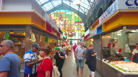 bakkaliye : MALAGA, SPAIN - SEPTEMBER 28, 2019: Interior of fresh fish section of Atarazanas central market, lined with stalls and decorated with large arched stained-glass window, on September 28 in Malaga