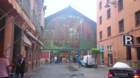 bakkaliye : MALAGA, SPAIN - SEPTEMBER 28, 2019: Large stained-glass window, depicting old town and ships, on the facade of Atarazanas central market, Calle Olozago street, on September 28 in Malaga
