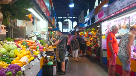 banan : MALAGA, SPAIN - SEPTEMBER 28, 2019: Produce section of Atarazanas central market with stalls, offering local and exotic fruits and vegetables, on September 28 in Malaga