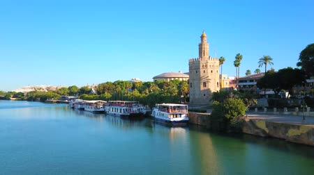 bank tower : SEVILLE, SPAIN - OCTOBER 2, 2019: Panorama of Guadalquivir river, Casco Antiguo district with Torre del Oro (Golden Tower) and Triana district with riverside parks and cafes, on October 2 in Seville