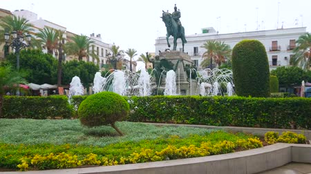 rivera : JEREZ, SPAIN - SEPTEMBER 20, 2019: The beautiful fountain and topiary garden surround equestrian statue of Miguel Primo de Rivera, situated in Plaza del Arenal, on September 20 in Jerez