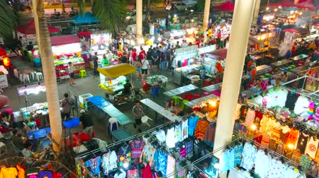 kolumna : PATONG, THAILAND - MAY 1, 2019: The vibrant life of evening Banzaan Night Bazaar with many small stalls, outdoor cafes and street vendors, on May 1 in Patong Wideo