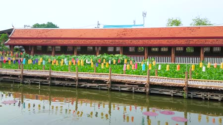 CHIANG MAI, THAILAND - MAY 4, 2019: Panorama of Wat Chetlin (Jedlin, Jetlin) temple with bamboo walkway, decorated with colorful lanterns, pond and shrine, on May 4 in Chiang Mai