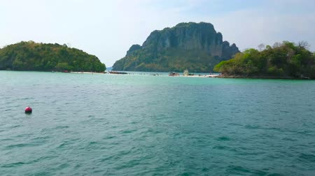 The yacht trip along Andaman sea islands with a view on Koh Mor and Koh Tup Islands, connected with a sand spit, and Ko Poda Nok (Chicken) Island on background, Ao Nang, Thailand Stock Footage