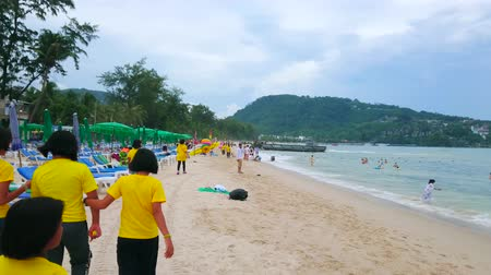güneydoğu : PATONG, THAILAND - APRIL 30, 2019: A cloudy morning is the perfect time to walk along the coast and enjoy the gentle tide, windy weather and local landscapes, on April 30 in Patong