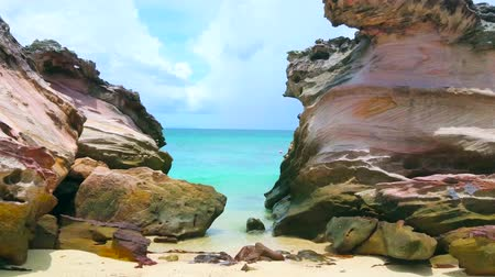 Enjoy Andaman seascape through the giant colored rocks at the shore of Khai Nai island, Phuket, Thailand