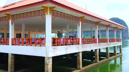 kolumna : KO PANYI, THAILAND - APRIL 28, 2019: The stilt building of the school of Muslim vilage, children have their classes in open air terace, on April 28 in Ko Panyi