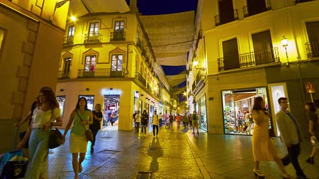 luksus : SEVILLE, SPAIN - OCTOBER 1, 2019: The evening walk through the busy Calle Velazquez shopping street with many brand stores and boutiques, on October 1 in Seville